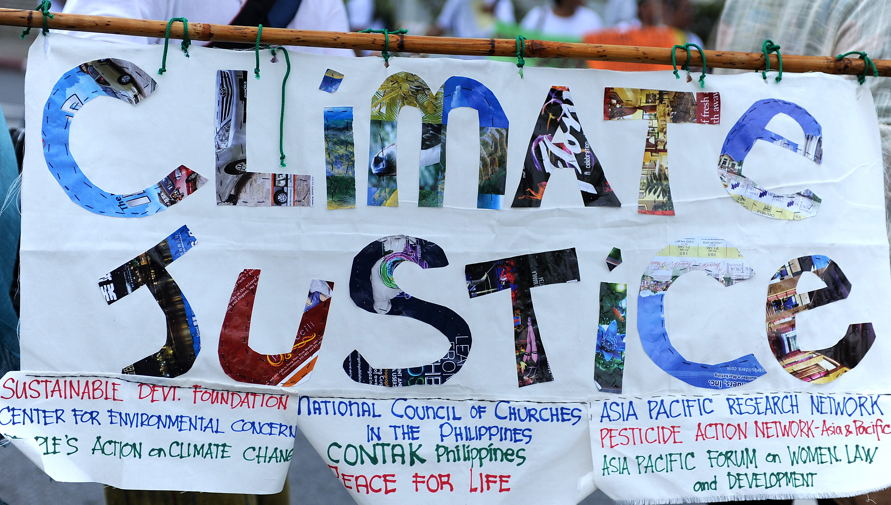 climate justice banner - Photo credit: Columnf.com